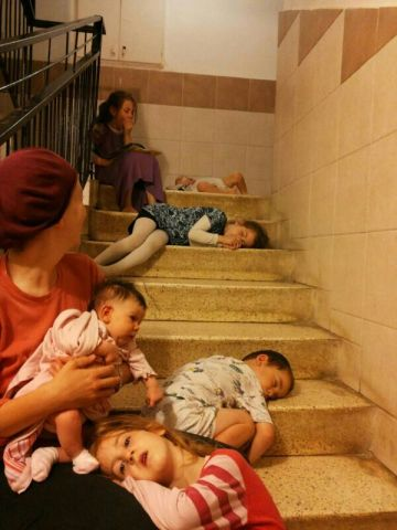 Kiryat Malachi, southern Israel: a family sleeps in the stairwell because of constant rocket fire