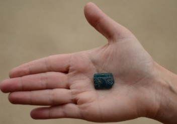 Ancient glass bead engraved with a Menorah