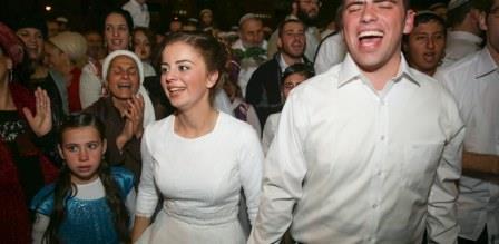 Sarah Techiya Litman and Ariel Biegel celebrate at their wedding