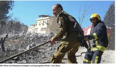 IDF officer and Palestinian firefighter working together